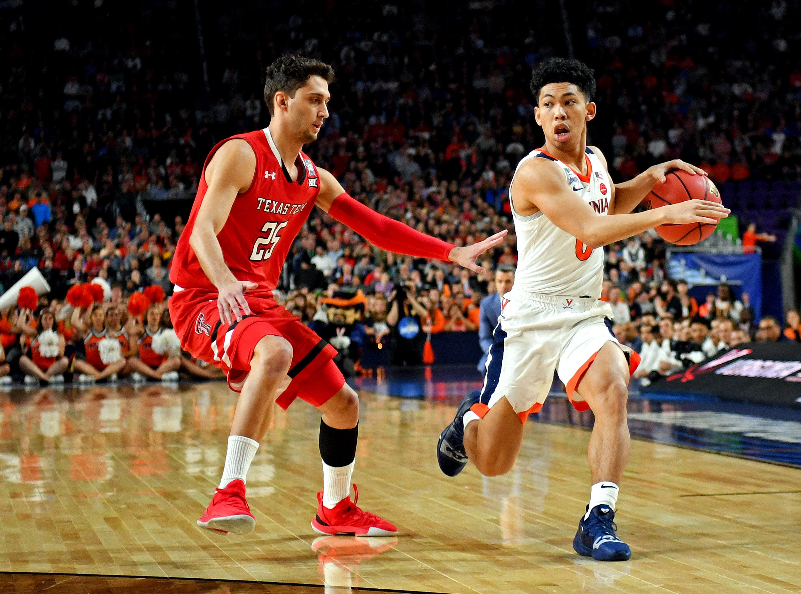 Apr 8, 2019; Minneapolis, MN, USA; Virginia Cavaliers guard Kihei Clark (0) handles the ball against Texas Tech Red Raiders guard Davide Moretti (25) during the first half in the championship game of the 2019 men's Final Four at US Bank Stadium. Mandatory Credit: Bob Donnan-USA TODAY Sports