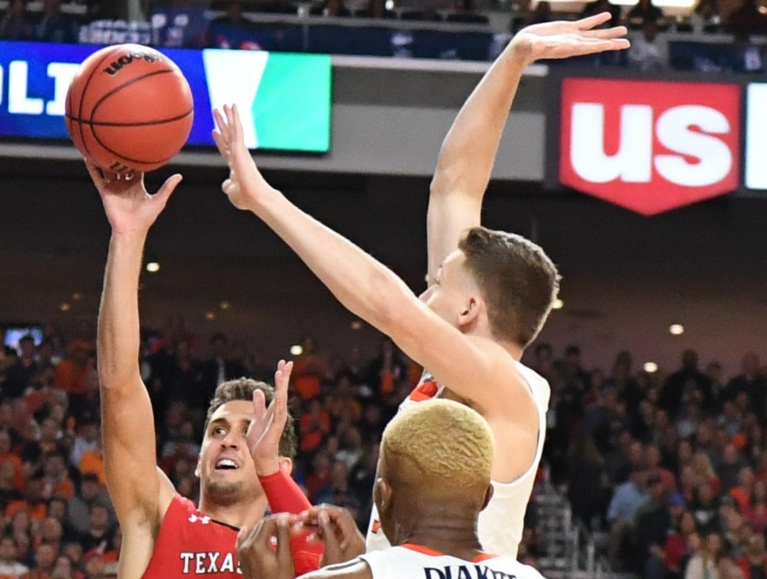 Apr 8, 2019; Minneapolis, MN, USA; Texas Tech Red Raiders guard Davide Moretti (25) shoots against Virginia Cavaliers guard Kyle Guy (5) and forward Mamadi Diakite (25) in the first half in the championship game of the 2019 men's Final Four at US Bank Stadium. Mandatory Credit: Robert Deutsch-USA TODAY Sports