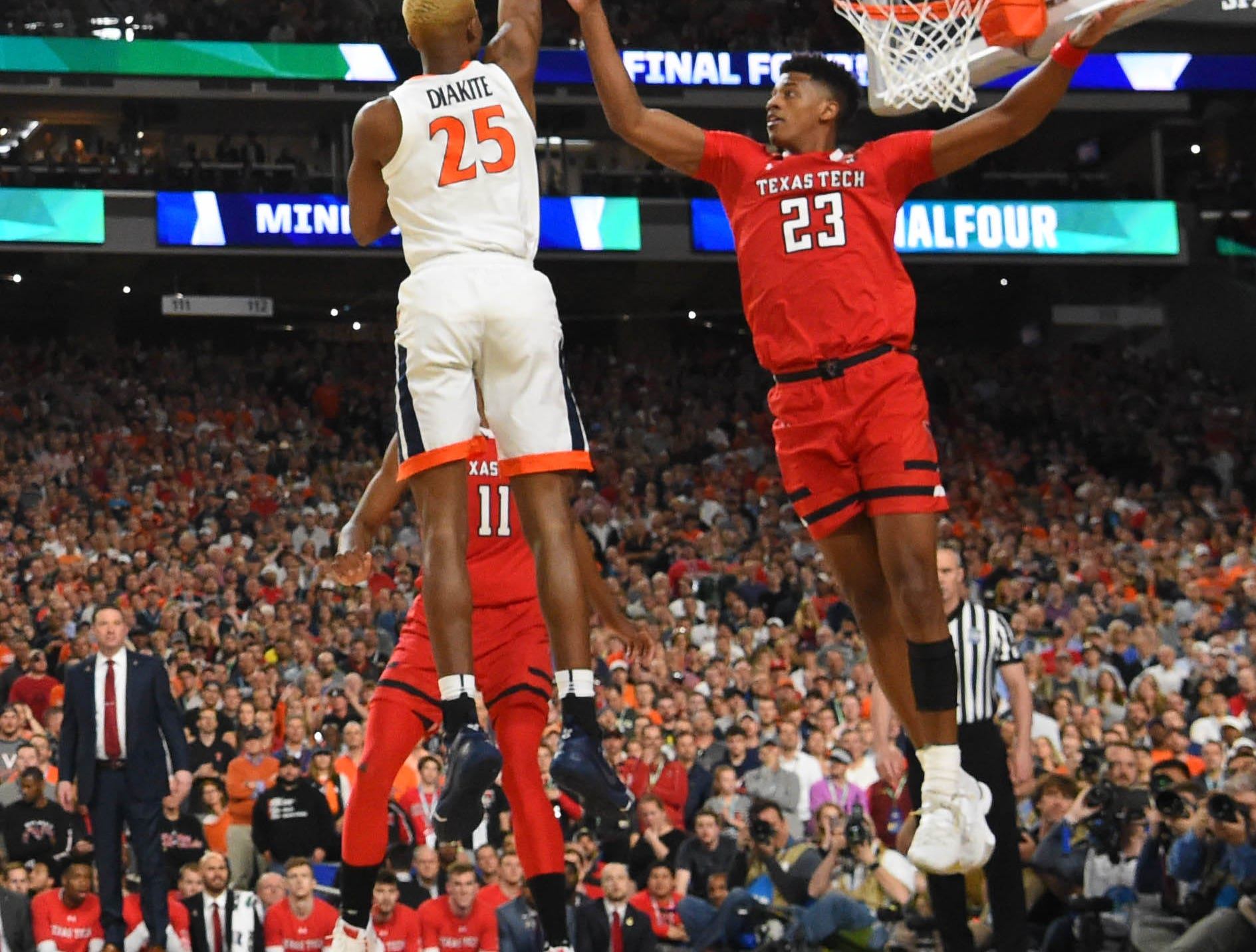 Apr 8, 2019; Minneapolis, MN, USA; Virginia Cavaliers forward Mamadi Diakite (25) over Texas Tech Red Raiders guard Jarrett Culver (23) during the first half in the championship game of the 2019 men's Final Four at US Bank Stadium. Mandatory Credit: Bob Donnan-USA TODAY Sports