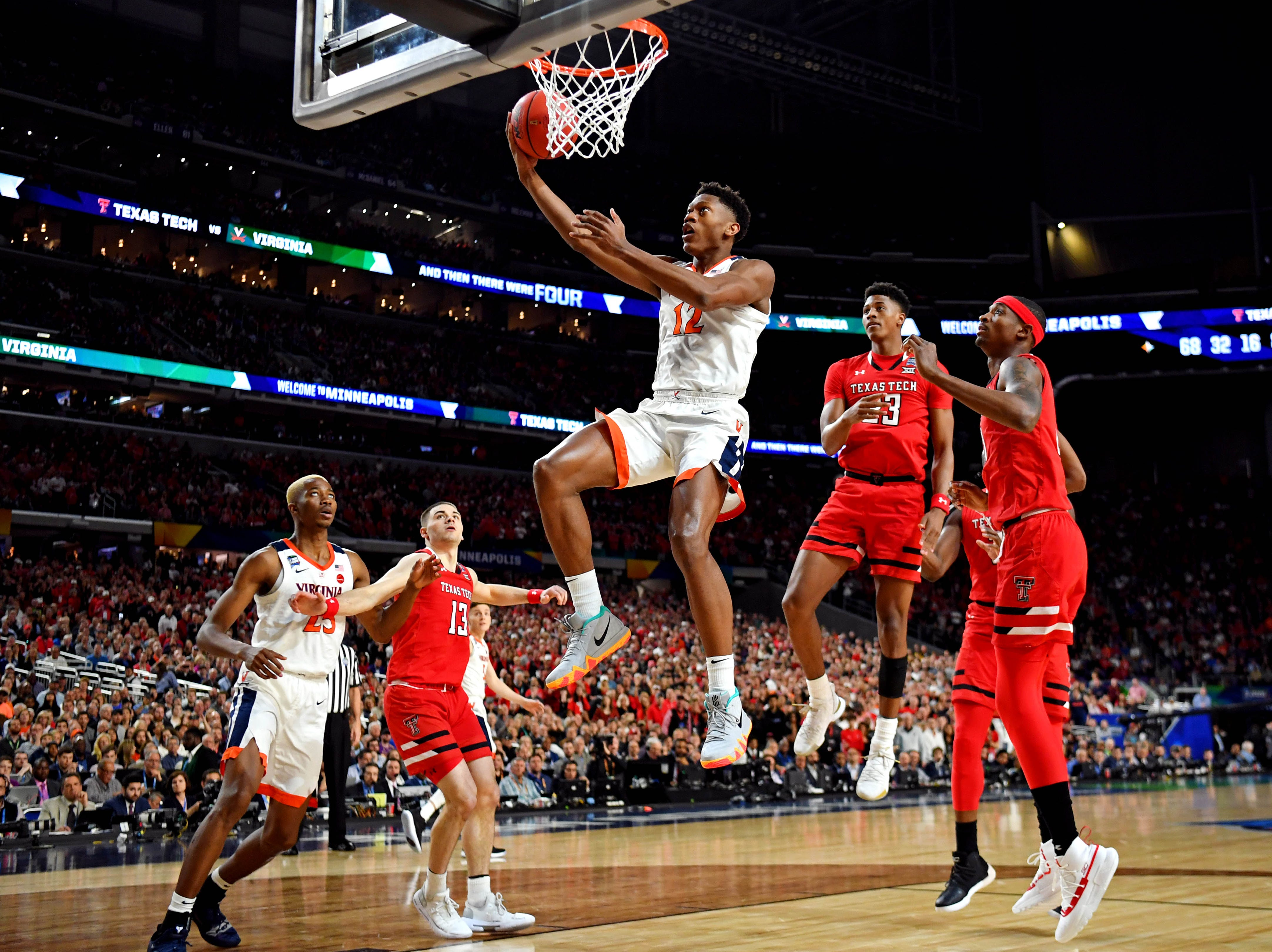 Apr 8, 2019; Minneapolis, MN, USA; Virginia Cavaliers guard De'Andre Hunter (12) shoots the ball against Texas Tech Red Raiders forward Tariq Owens (11) during the first half in the championship game of the 2019 men's Final Four at US Bank Stadium. Mandatory Credit: Bob Donnan-USA TODAY Sports