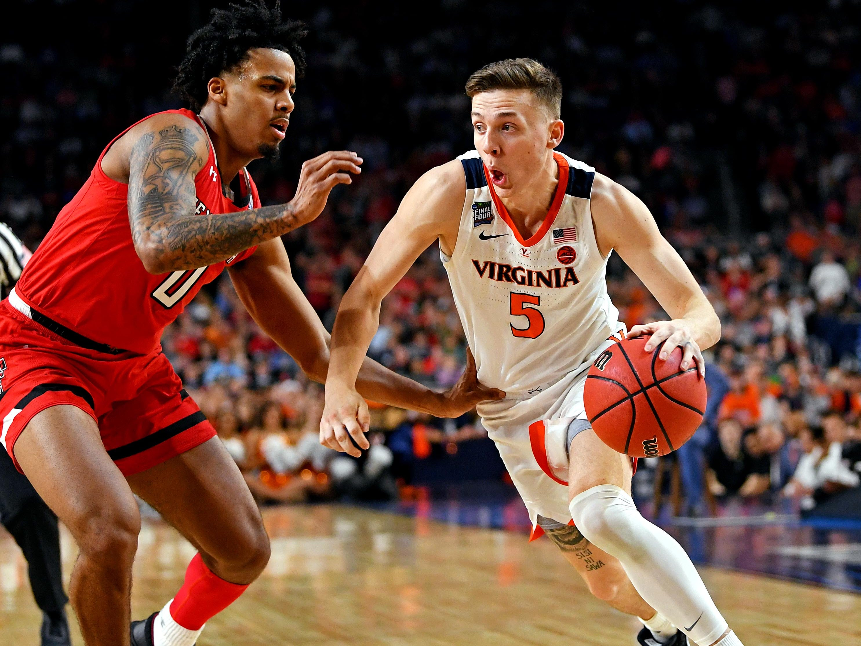 Apr 8, 2019; Minneapolis, MN, USA; Virginia Cavaliers guard Kyle Guy (5) drives to the basket against Texas Tech Red Raiders guard Kyler Edwards (0) during the first half in the championship game of the 2019 men's Final Four at US Bank Stadium. Mandatory Credit: Bob Donnan-USA TODAY Sports
