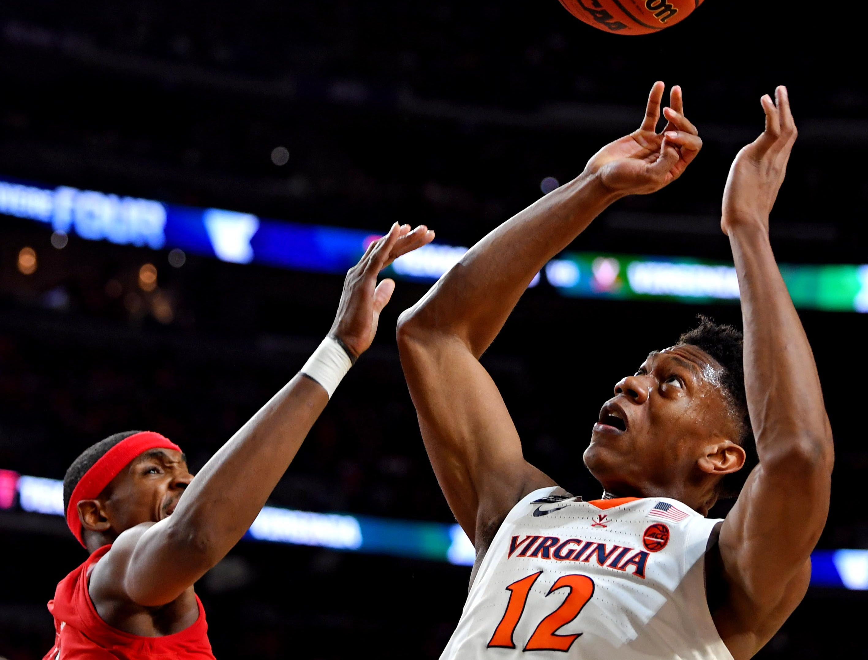 Apr 8, 2019; Minneapolis, MN, USA; Virginia Cavaliers guard De'Andre Hunter (12) and Texas Tech Red Raiders forward Tariq Owens (11) go for a rebound during the first half in the championship game of the 2019 men's Final Four at US Bank Stadium. Mandatory Credit: Bob Donnan-USA TODAY Sports