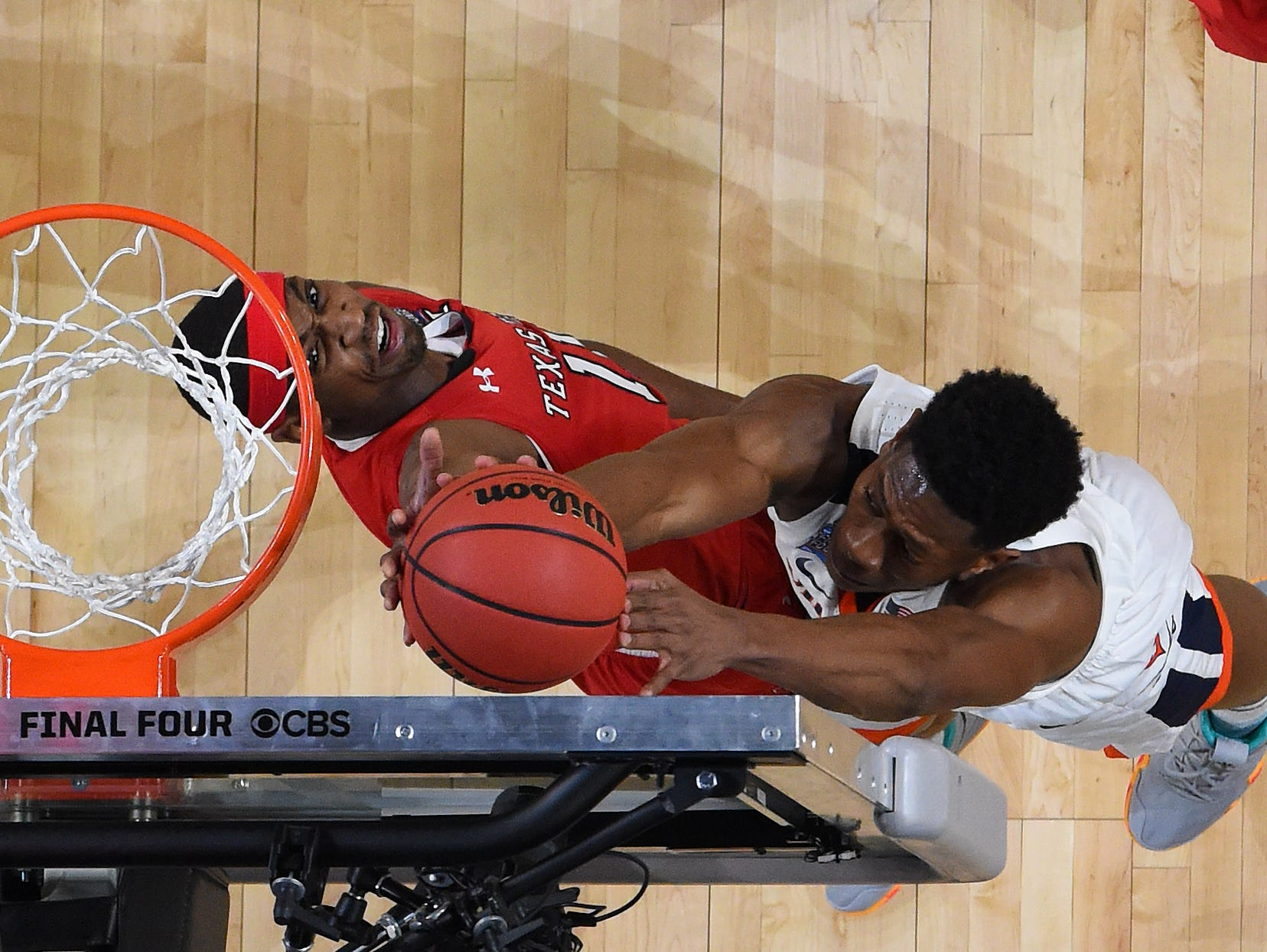 Apr 8, 2019; Minneapolis, MN, USA; Texas Tech Red Raiders forward Tariq Owens (11) blocks a shot attempt by Virginia Cavaliers guard De'Andre Hunter (white) during the first half in the championship game of the 2019 men's Final Four at US Bank Stadium. Mandatory Credit: Bob Donnan-USA TODAY Sports
