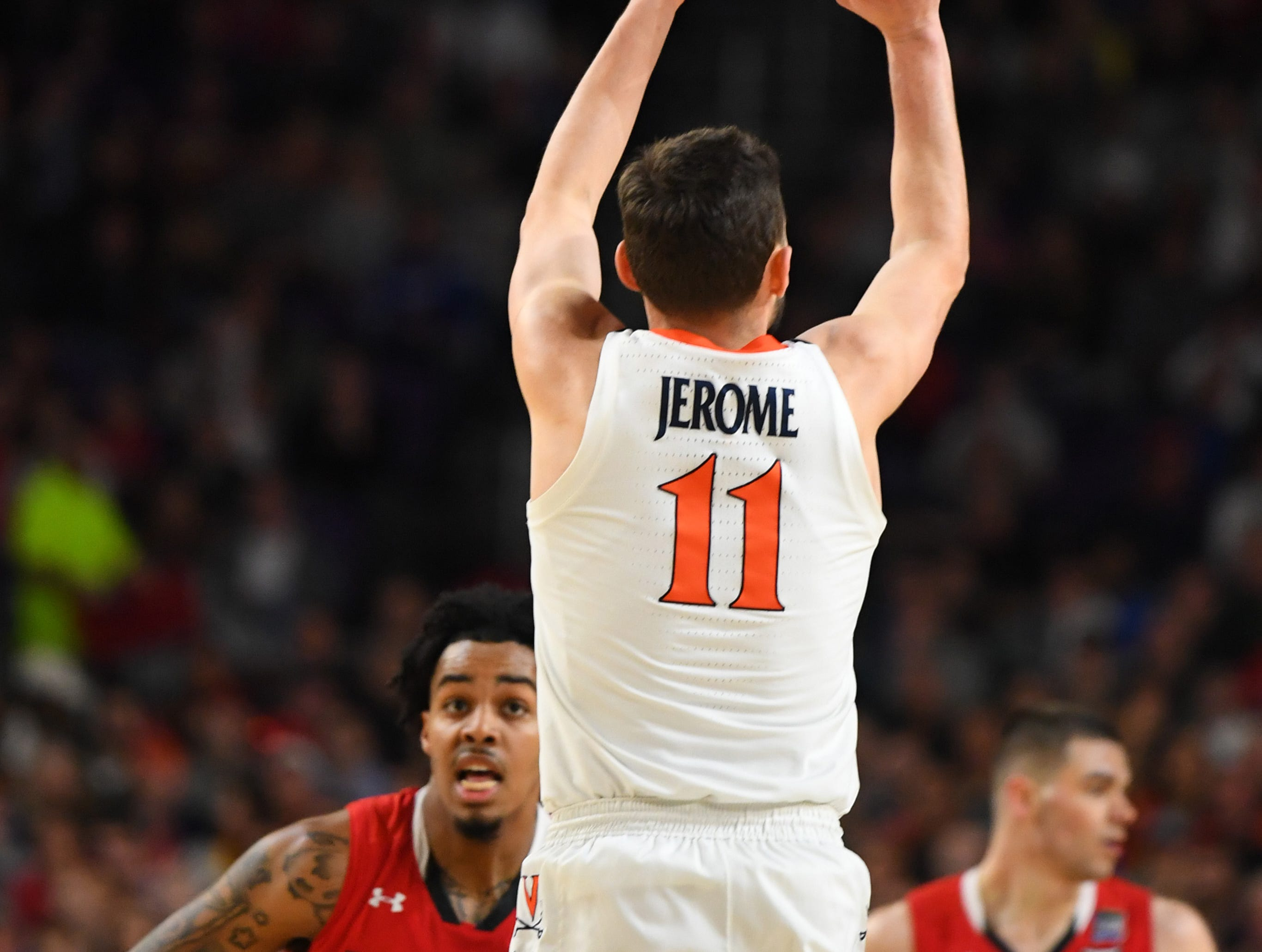 Apr 8, 2019; Minneapolis, MN, USA; Virginia Cavaliers guard Ty Jerome (11) hits a three-point shot at the end of the half against the Virginia Cavaliers in the championship game of the 2019 men's Final Four at US Bank Stadium. Mandatory Credit: Robert Deutsch-USA TODAY Sports