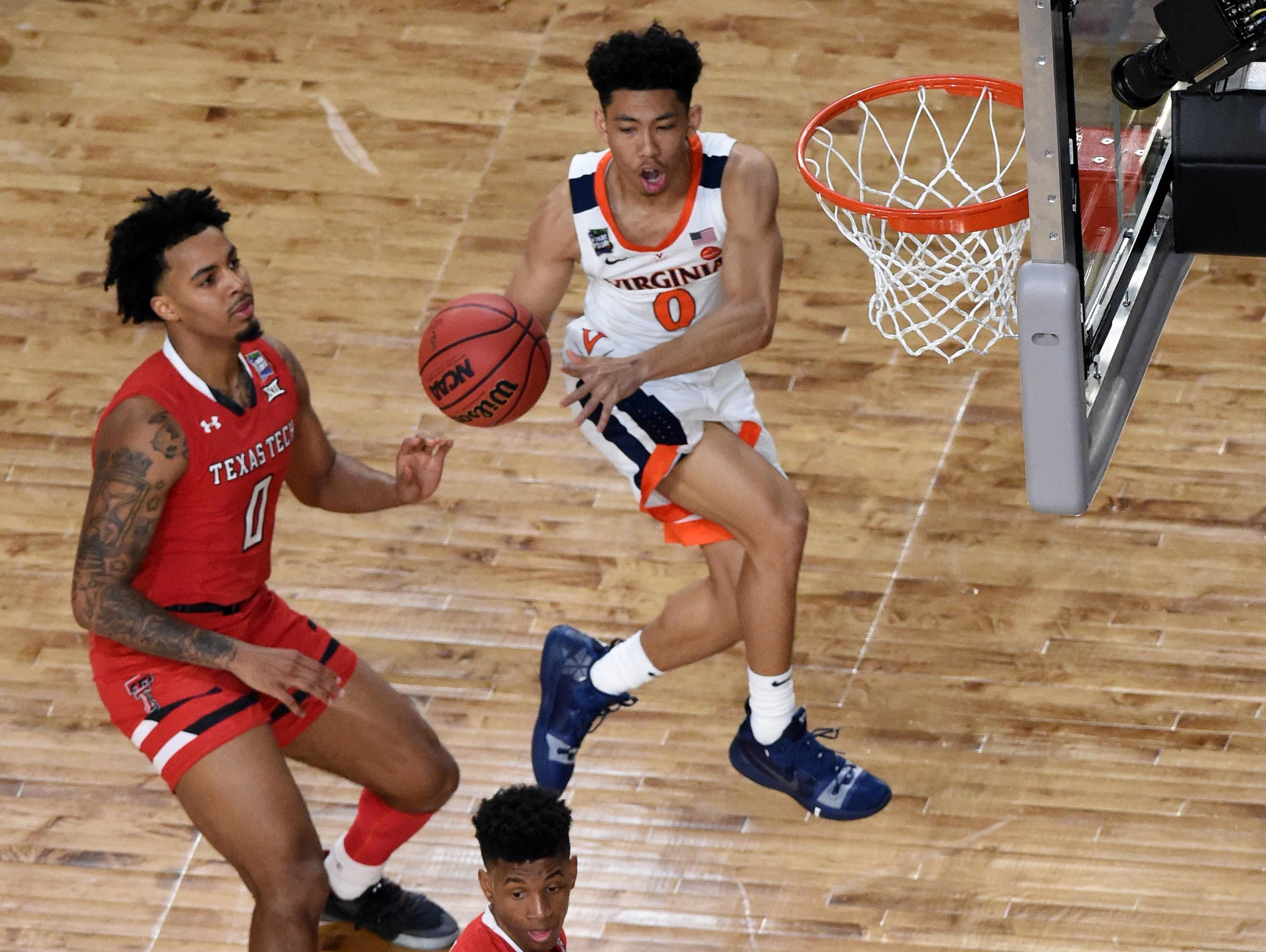 Apr 8, 2019; Minneapolis, MN, USA; Virginia Cavaliers guard Kihei Clark (0) passes as Texas Tech Red Raiders guard Kyler Edwards (0) and guard Jarrett Culver (23) defends during the first half  in the championship game of the 2019 men's Final Four at US Bank Stadium. Mandatory Credit: Bob Donnan-USA TODAY Sports