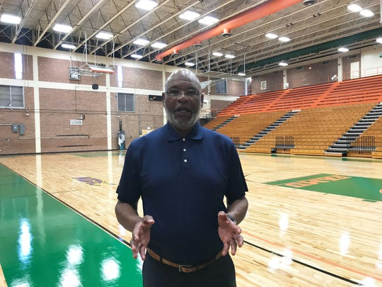 FAMU athletics director Dr. John Eason stands on the court inside Gaither Gymnasium.