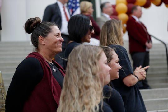 Members of the Florida State University softball team stand on the steps of the Historic Capitol while being recognized during FSU Day at the Capitol Tuesday, April 9, 2019.