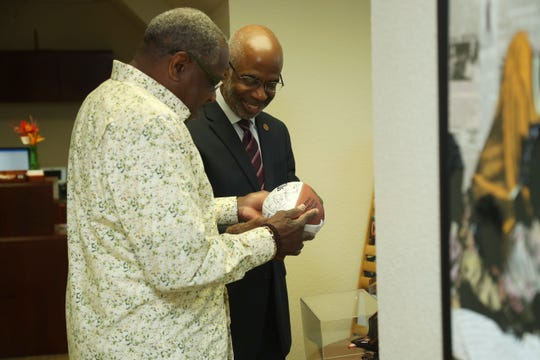 Former MLB player/manager Dusty Baker looks at an autographed football with FAMU president Dr. Larry Robinson. Baker visited the campus on Tuesday, April 9, 2019.
