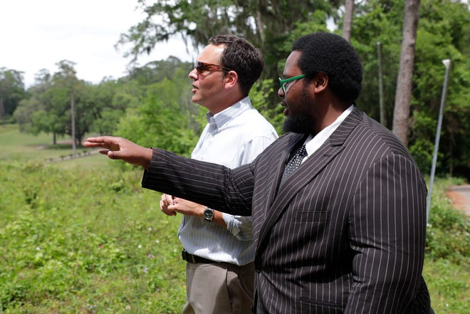 Jonathan Lammers, a historical preservation consultant, discusses the location of a burial site is believed to be at the Capital City Country Club with activist Delaitre Hollinger Tuesday, April 9, 2019.