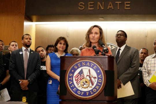 Aliki Moncrief, executive director of Florida Conservation Voters, speaks at a news conference held in opposition to Senate Bill 7096 in the fourth floor Capitol rotunda Tuesday, April 9, 2019.