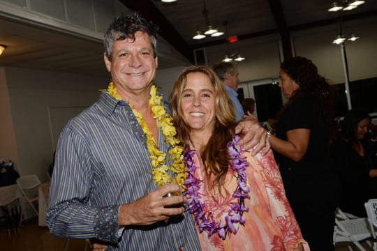 """Scott Strigl, left, and Natalie Boyland at """"Bubbles 4Boobies,"""" hosted by Windsor Community Angels at The Riverwalk Center in Fort Pierce."""