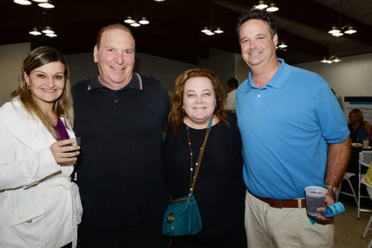 "Dunya Deiner, left, Dr. Elliott Scher, Lauri Goldstein and Brad Deiner at ""Bubbles 4 Boobies,"" hosted by Windsor Community Angels at The Riverwalk Center in Fort Pierce."