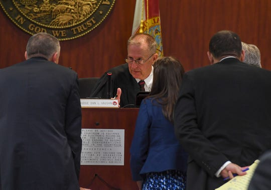 Circuit Judge Dan Vaughn (center) speaks with (from left) Chief Assistant State Attorney Tom Bakkedahl, and Assistant Public Defenders Dorothy Naumann, Brett Peters, and Alan Hunt during the second day of jury selection for the retrial of defendant Henry Lee Jones Jr., on Tuesday, April 9, 2019, at the Indian River County Courthouse in Vero Beach.