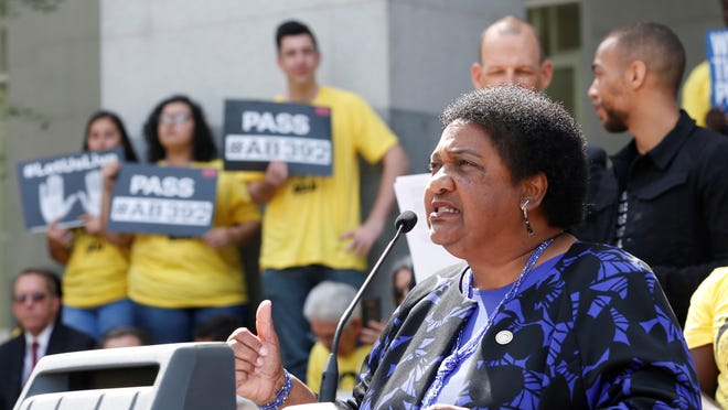 Assemblywoman Shirley Weber, D-San Diego, discusses her proposed measure to limit the use of deadly force by police during a rally at the Capitol in Sacramento in this file photo.