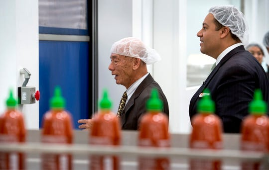 In this 2014 photo, Huy Fong Foods CEO David Tran and Jason Villalba, then a Texas state representative, tour the company's Irwindale factory.
