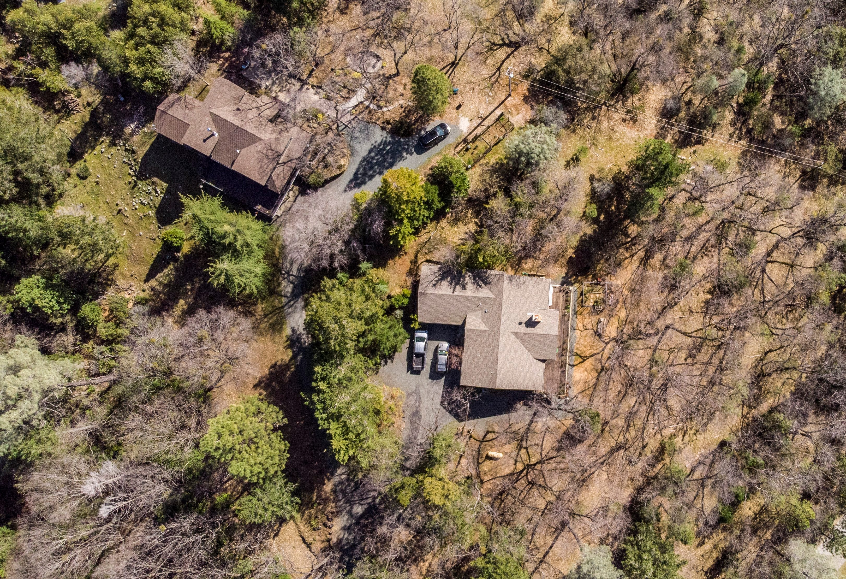 Gene Mapa lost his Paradise home in the Camp Fire. Now he lives in a house in Colfax, which also has a high level of fire risk. He's had his house, right, inspected by the California Department of Forestry and maintains defensible space.