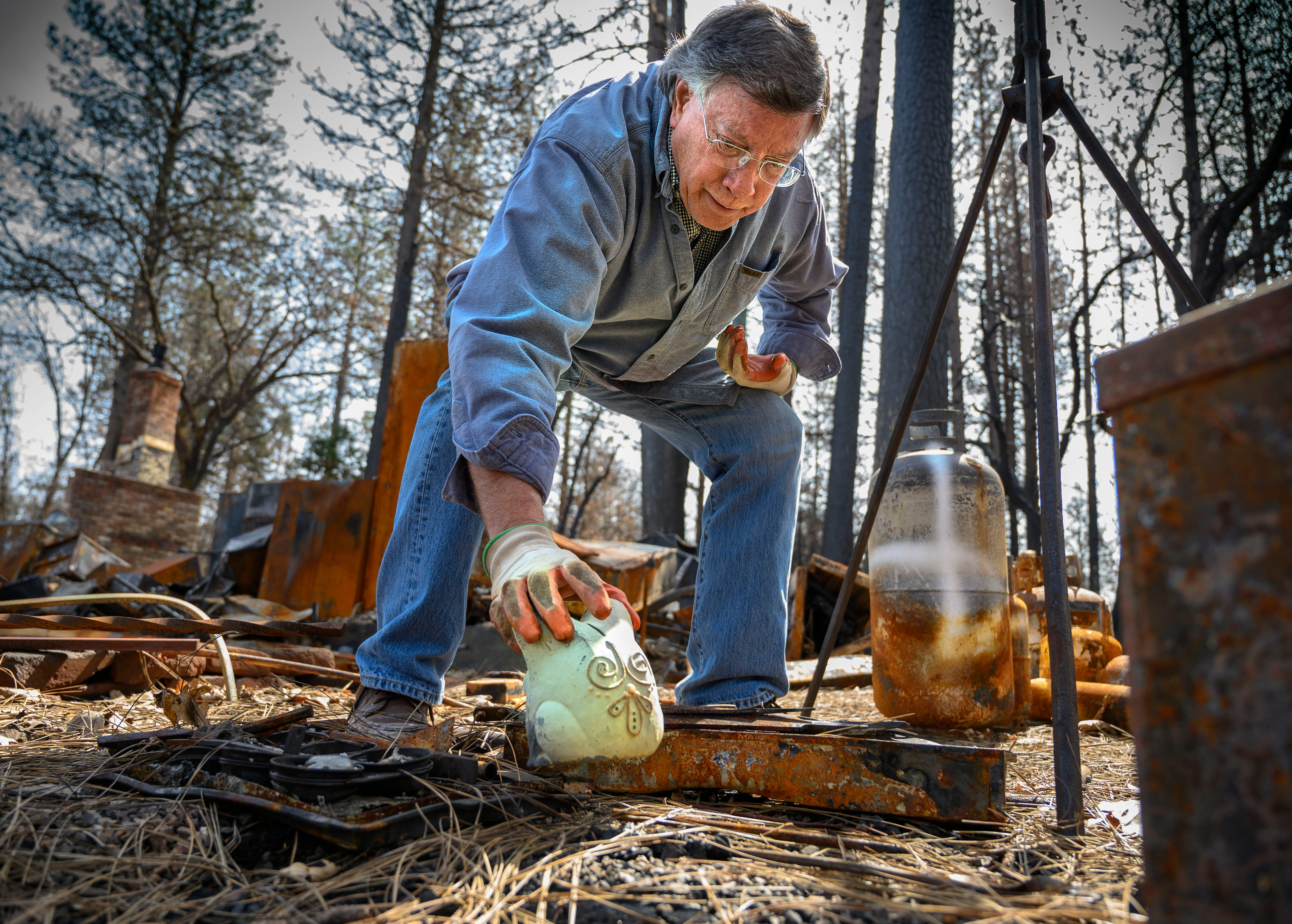 Gene Mapa collects metal and ceramic objects that didn't burn in the Camp Fire at his house in Paradise. Mapa now lives in Colfax, which as a similar level of fire risk.