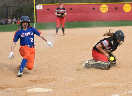 Millville's Abbi Markee scores a run in last year's 4-3 win over Vineland.