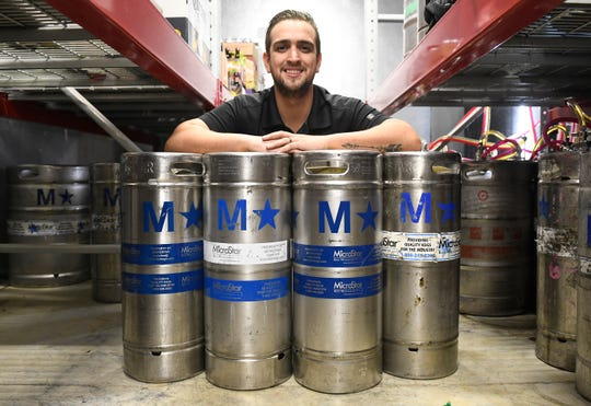 Luis Quelhas, bar manager at The Brass Tap in Vineland, stands behind four limited Oskar Blues Ten FIDY barrel-aged variant kegs. The beer will be tapped during a special event on Wednesday, April 10, 2019.