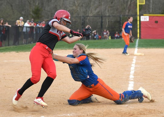 Millville's Liv Powers makes a play at home plate to end the fifth inning against Vineland. The Thunderbolts topped the Fighting Clan 4-3.