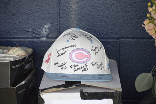 The Central Valley Christian High School baseball team gave a signed baseball cap to Stacey Marshall, the mother of Cavaliers' head coach Shane Marshall. Stacey was diagnosed with cancer in 2018.
