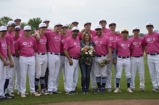 The Central Valley Christian High School baseball team held a pre-game ceremony for Stacey Marshall, the mother of head coach Shane Marshall, on April 5, 2019. Stacey Marshall was diagnosed with breast cancer last year.