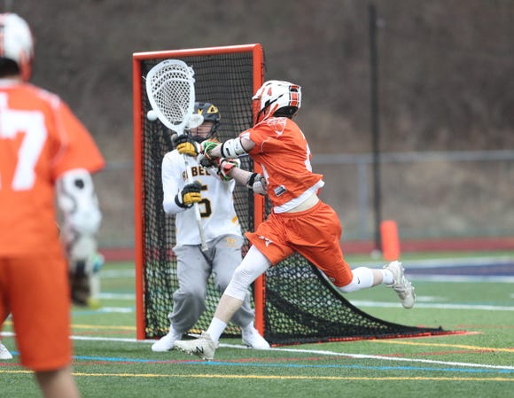 Mamaroneck's Tom Conley (4) scores a goal in Lakeland/Panas goalie JB Walsh (5)  during boys lacrosse action at Walter Panas High School in Cortlandt on Tuesday, April 9, 2019.