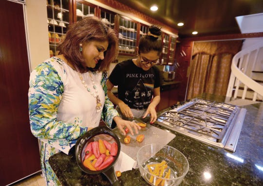 Hetal Gor and her daughter Anya, 16, prepare dinner at their home in Tenefly, N.J. April 1, 2019. The two spoke about the fact that that there are two Democratic candidates for President with Indian and Hindu connections. Anya will be eligible to vote in the 2020 general election.