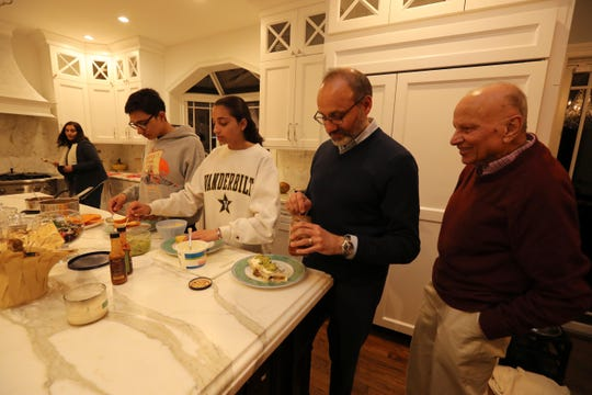 From left, Bella Sheth, her son Kiran, 16, daughter Serena, 18, her husband Haresh, and Rashmi Sheth, Hareth's father, put together a Mexican dinner at their home in Chappaqua April 1, 2019. 