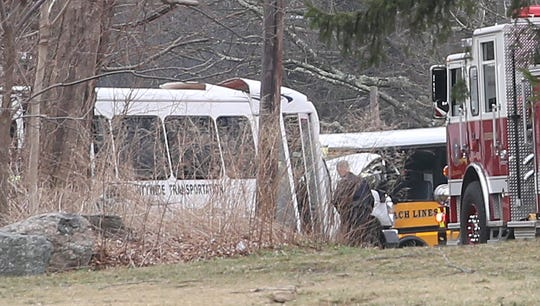 Greenwich rescue workers at the scene of an accident involving two buses in front of the Brunswick School on King Street in Greenwich near the border of Westchester County on April 9, 2019.