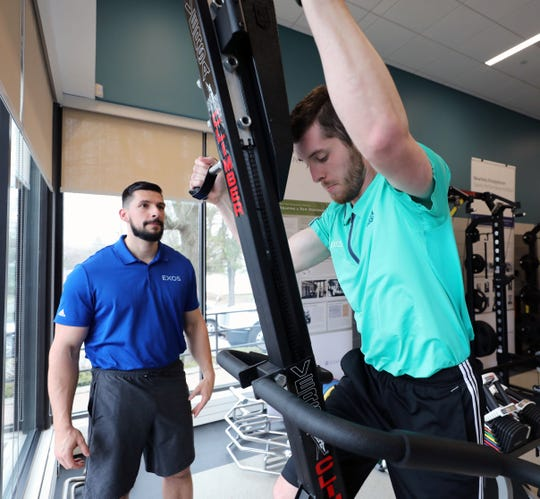 Zach Chiaramone, a performance advisor, works out on a climbing machine as Josh Adams, the performance director for EXOS looks on, at the New York-Presbyterian and Columbia University Irving Medical Center's Sports Medicine and Performance Training Facility at the Vernon Place Shops in Scarsdale, April 9, 2019. EXOS designs and delivers proactive health and performance game plans that guide people to higher levels of success.