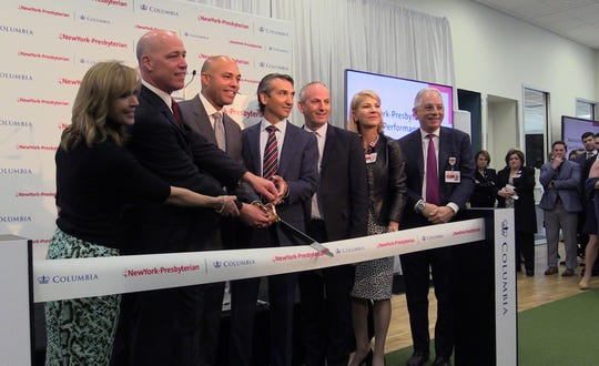 Officials cut the ribbon at the opening of the New York-Presbyterian and Columbia University Irving Medical Center's new Sports Medicine and Performance Training Facility at the Vernon Place Shops in Scarsdale, April 9, 2019.