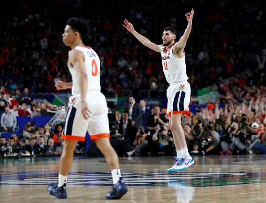 Virginia's Ty Jerome (11) reacts after shooting a 3-point basket during the first half in the championship of the Final Four NCAA college basketball tournament against Texas Tech, Monday, April 8, 2019, in Minneapolis.