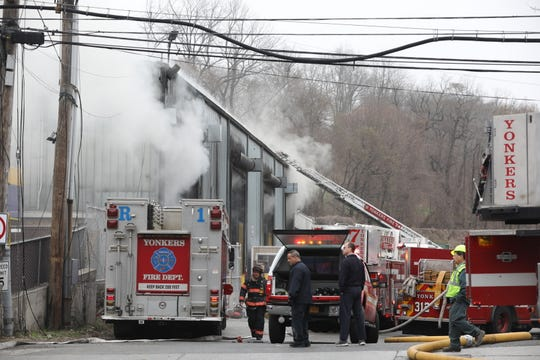 Yonkers Fire Department battles a trash fire inside the commercial building at Waste Management on Yonkers Avenue in Yonkers.