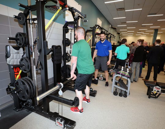 Jason Hutchings, the site performance manager works out on a weight machine as Josh Adams, the performance director for EXOS looks on, at the New York-Presbyterian and Columbia University Irving Medical Center's Sports Medicine and Performance Training Facility at the Vernon Place Shops in Scarsdale, April 9, 2019. EXOS designs and delivers proactive health and performance game plans that guide people to higher levels of success.