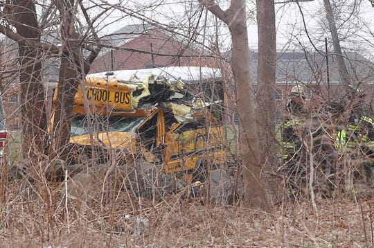 Greenwich firefighters work at the scene of an accident involving two buses in front of the Brunswick School on King Street in Greenwich near the border of Westchester County on April 9, 2019.