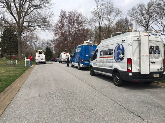 News stations line the street in front of the family home of Staff Sgt. Christopher Slutman, a New York City firefighter with Delaware ties who was killed Monday in an explosion in Afghanistan.