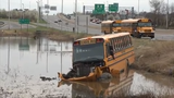 Raw Video: School Bus crashes into pond