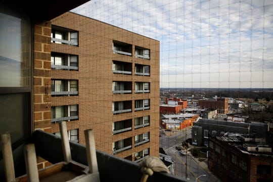 This Feb. 26, 2019, photo shows Rosemont Tower in Baltimore from a resident's balcony. Health and safety inspectors gave the 200-unit public housing high-rise a failing score of 25 out of a possible 100 in 2017 and then last year a score of 71, according to the housing authority. Largely due to complexes such as Rosemont Tower, since 2013 Maryland had the country's highest inspection failure rate for public housing at 32%. (AP Photo/Patrick Semansky)