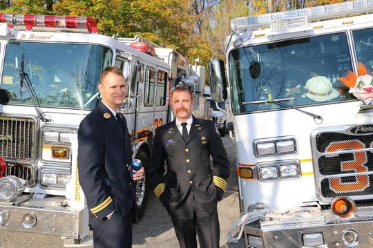 Christopher Slutman (left) and Former Fire Kentland Chief Michael Mattison (right). Slutman was a life member of the Kentland Volunteer Fire Department in Maryland, and also worked for the Fire Department of New York in the Bronx.