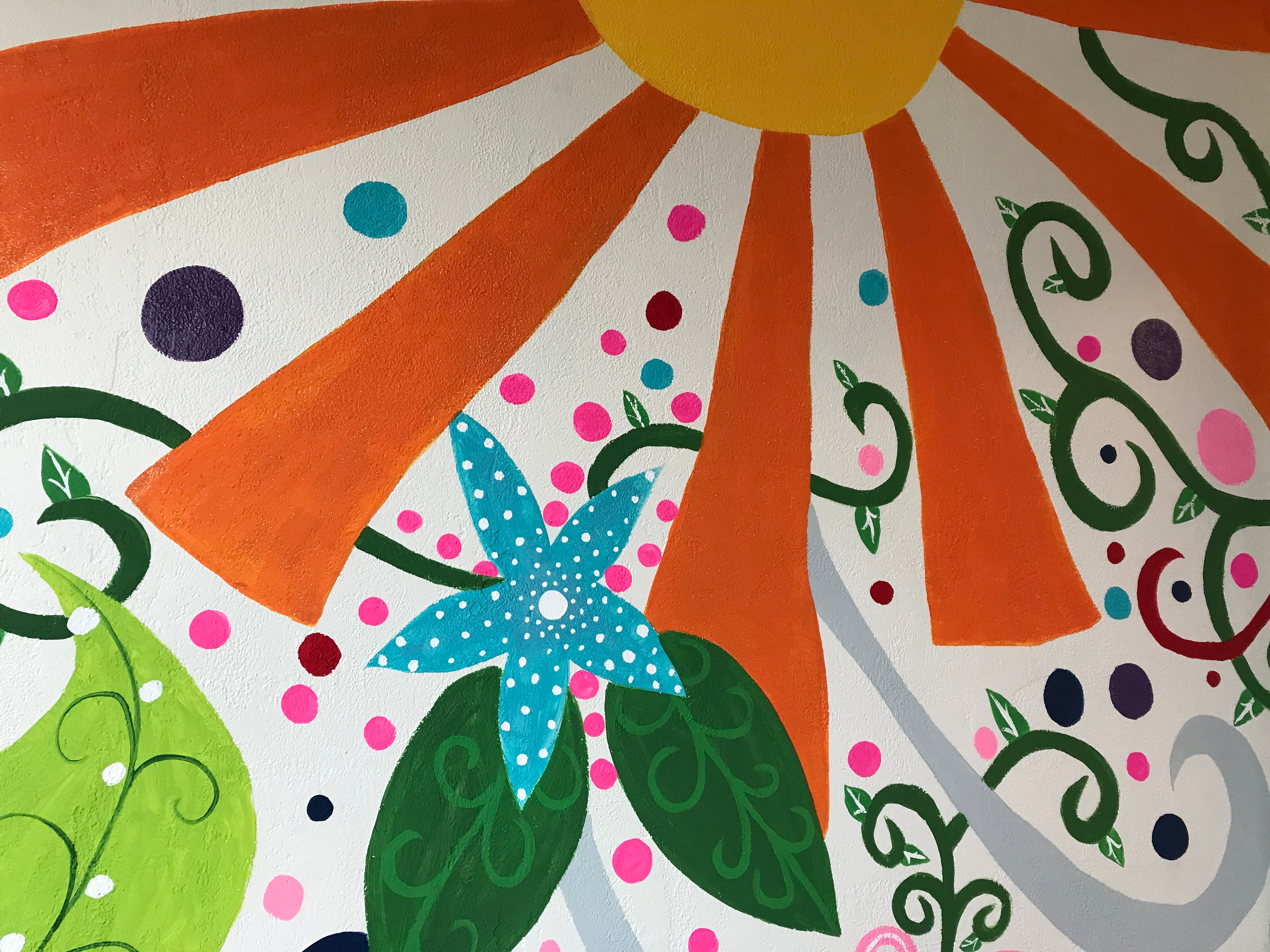 Jenn Sammartino painted a mural inside her cupcake and edible cookie dough shop in Wisconsin Rapids.