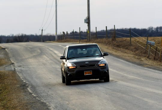 A car driven by Geoff Gretton, takes Ismael Castellanos from his his home in Bethany, N.Y., to a Green Light, N.Y. meeting at SUNY Geneseo, where Castellanos and other members of the immigrant community advocated for obtaining driver's licenses.