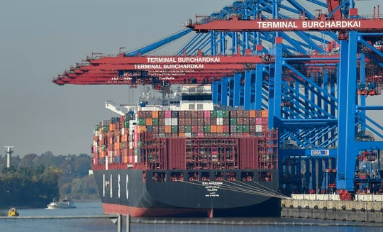 A container ship is loaded at the harbor in Hamburg, Germany. The United States is considering putting tariffs on $11 billion in EU goods per year to offset what it says are unfair European subsidies for planemaker Airbus.