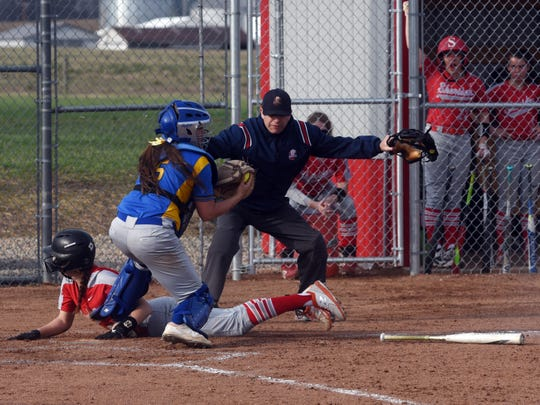 Taylor Pagan is called safe after sliding into home during Sheridan's 4-2 win on Monday against visiting Maysville.
