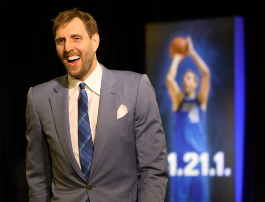 Dallas Mavericks forward Dirk Nowitzki enters the arena before the game against the Phoenix Suns.