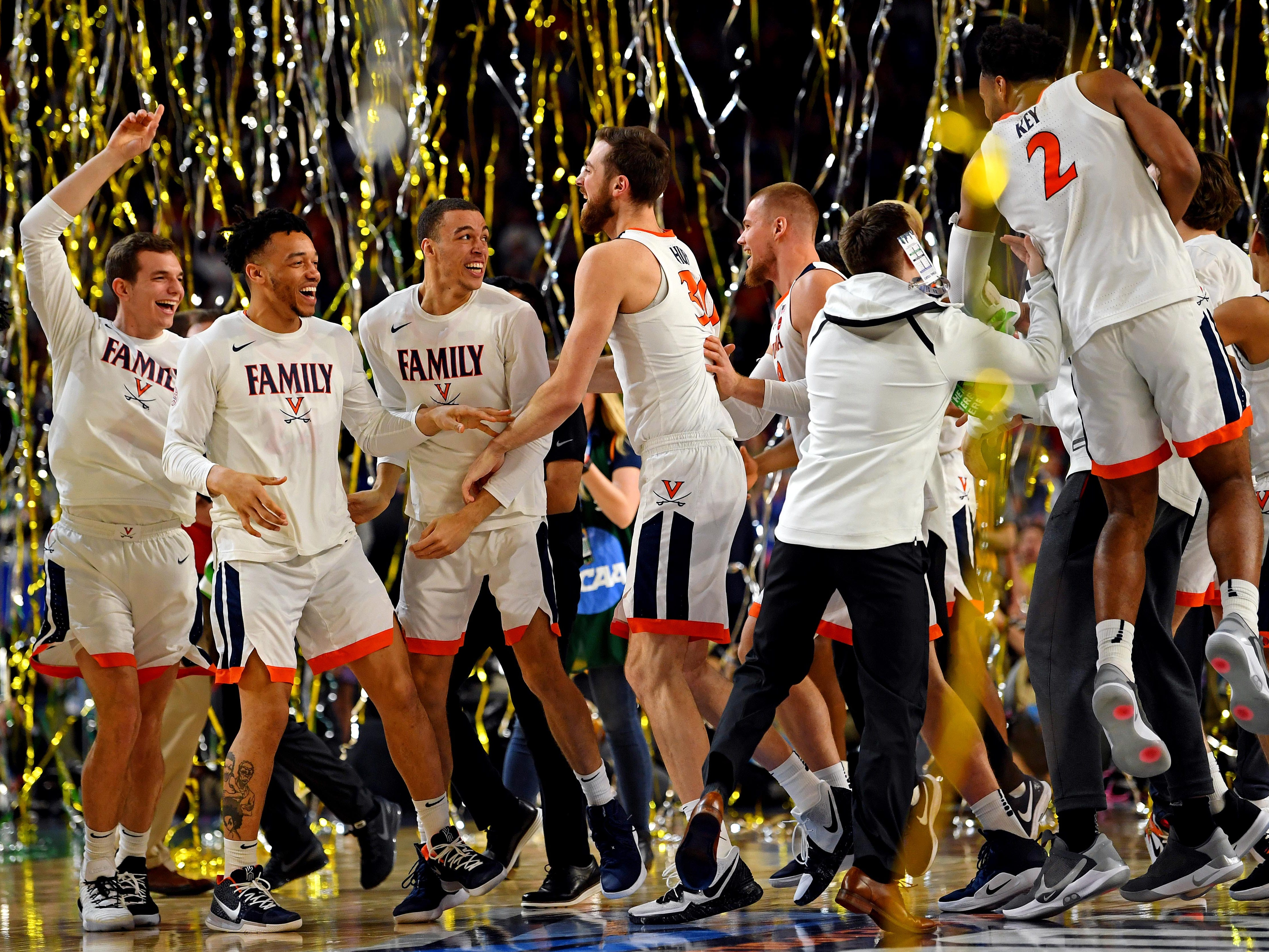 Virginia players celebrate after winning the national title game.