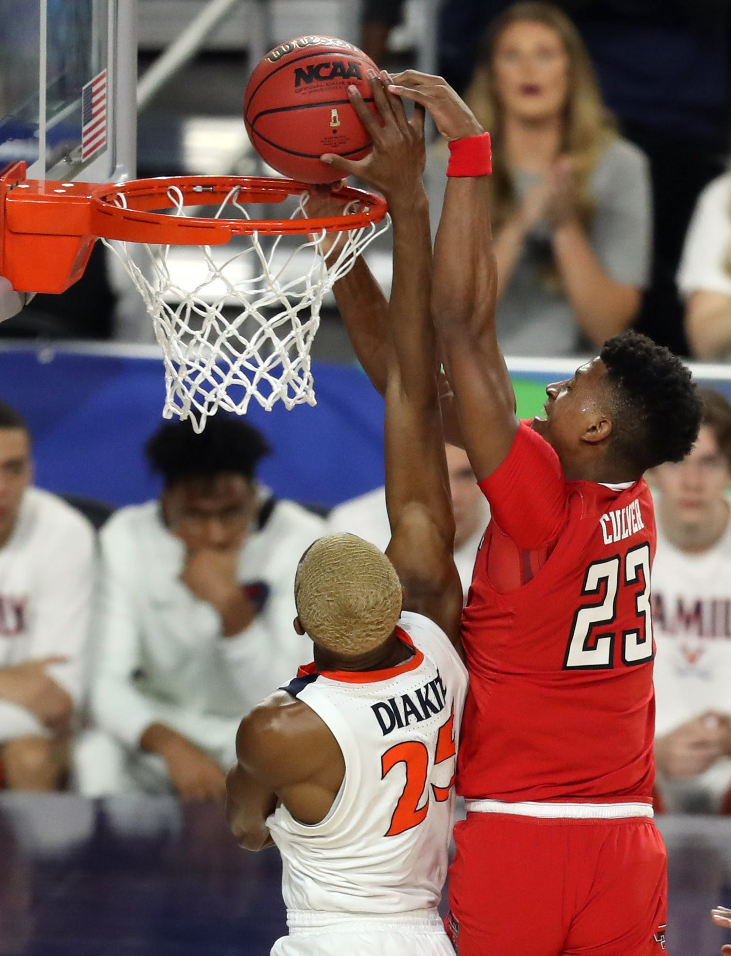 Virginia's Mamadi Diakite (25) blocks the shot of Texas Tech's Jarrett Culver during the first half in the championship game.