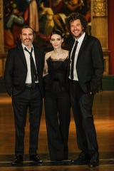 "Joaquin Phoenix, left, Rooney Mara and ""Mary Magdalene"" director Garth Davis in London in 2018."