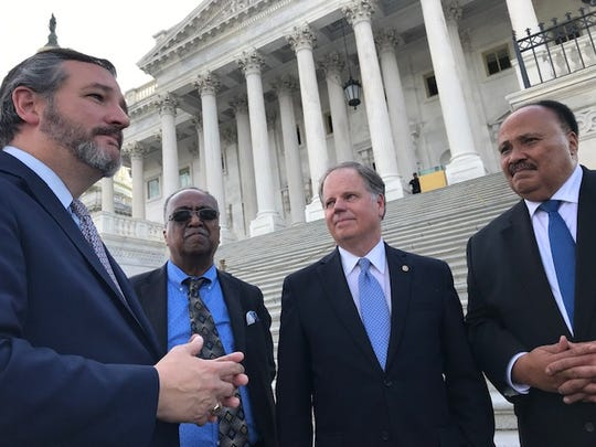 "Sen. Ted Cruz, R-Texas, (left) joins Charles Steele, Sen. Doug Jones, D-Ala., and Martin Luther King III outside the U.S. Capitol April 9, 2019 after reading excerpts of Martin Luther King Jr., ""Letters from Birmingham Jail."""