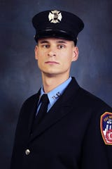 This undated photo, provided in New York, on April 9, 2019, shows Fire Department of New York firefighter Christopher Slutman. Slutman, a 15-year member of the Fire Dept. of New York, was among three American service members killed by a roadside bomb in Afghanistan on Monday.